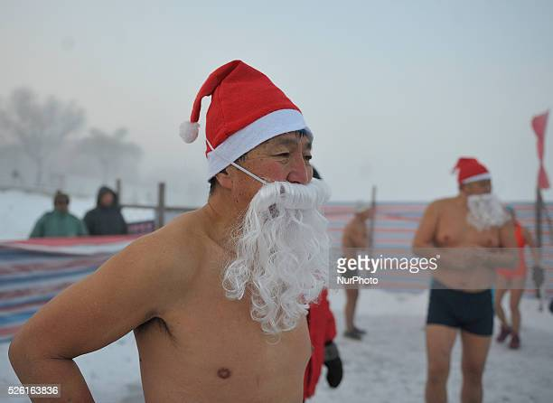 Chinese people swimming with Santa's Hat and beard to celebrate Christmas in the Songhujiang riverin minus 26 degree celsius temperature in Harbin...