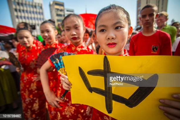 Chinese people take part in a flash mob in Sao Paulo Brazil on August 19 2018 About 100 Chinese women and children accompanied by voices and...