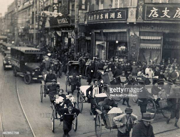 Chinese people try to evacuate to the International settlement during the Shanghai Incident on January 28 1932 in Shanghai China