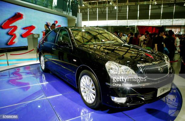 Chinese people view a Red Flag HQ3 limousine of China First Automobile Works Group at the Auto Shanghai 2005 Exhibition on April 23, 2005 in...