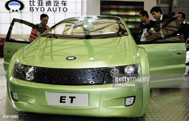 """Chinese people view BYD Auto company's new car """"ET"""" at the Auto Shanghai 2005 Exhibition on April 21, 2005 in Shanghai, China. Top world automakers..."""