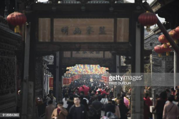 Chinese people visit the old city during the Lunar New Year marking the Year of the Dog in Hancheng Shaanxi province on February 16 2018 The Lunar...