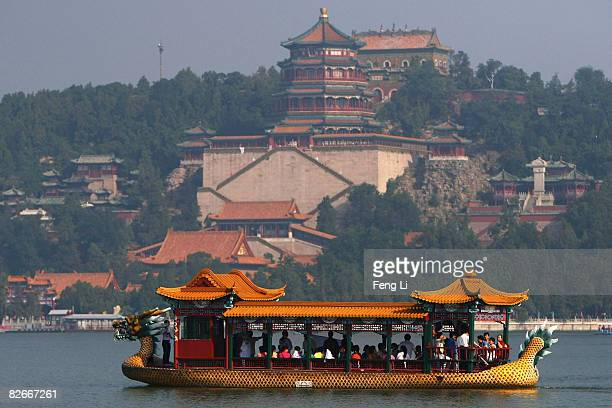 Chinese people watch the Beijing 2008 Paralympic torch relay on the Kunming Lake of the Summer Palace on September 5 2008 in Beijing China The...