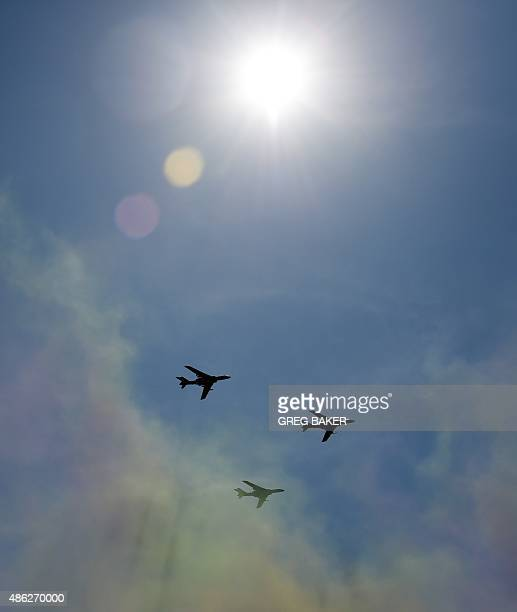 Chinese People's Liberation Army Air Force aircraft fly in formation over Tiananmen Square in Beijing on September 3 during a military parade to mark...