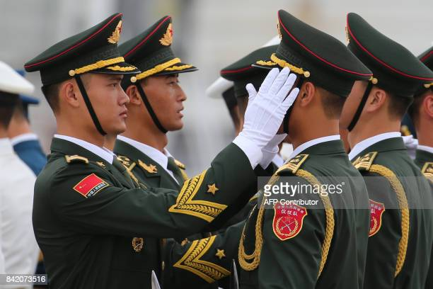 Chinese People's Liberation Army honor guard prepare for Brazil's President Michel Temer arrival at Xiamen Gaoqi International Airport to attend the...