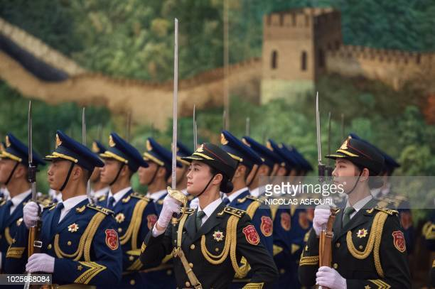 A Chinese People's Liberation Army honour guard stands in formation during the welcoming ceremony for Ghana President Nana AkufoAddo at the Great...