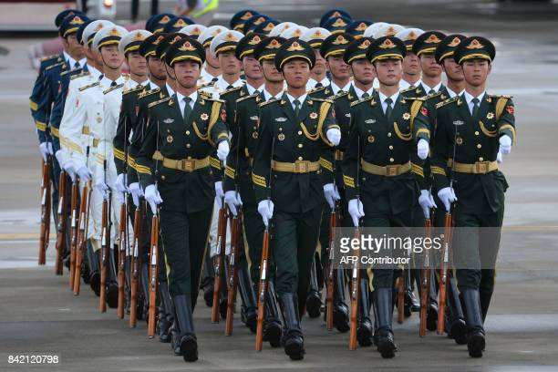 Chinese People's Liberation Army honour guards march following the arrival of Russian President Vladimir Putin at the Xiamen Gaoqi International...