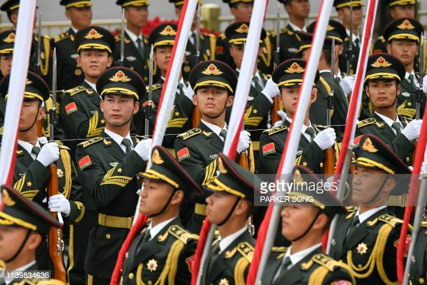 Chinese People's Liberation Army honour guards prepare for a welcome ceremony for Austrian Chancellor Sebastian Kurz at the Great Hall of the People...