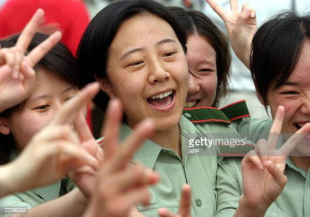 Chinese People's Liberation Army nurses celebrate after the last batch of SARS patients was discharged from the Xiaotangshan SARS hospital in the...