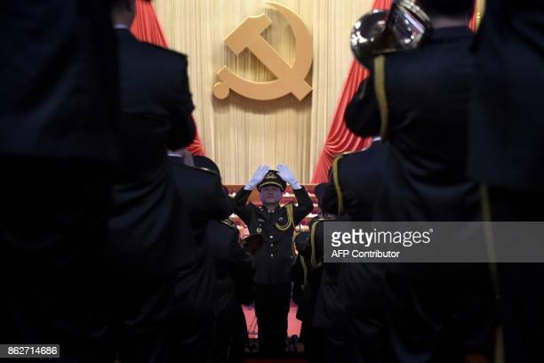 Chinese People's Liberation Army officer practices conducting a military band before the opening session of the Chinese Communist Party's five-yearly...