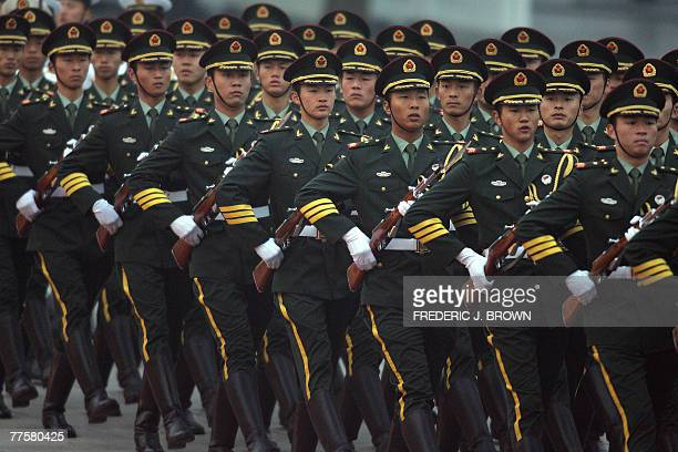 Chinese People's Liberation Army officers march during a welcoming ceremony for visiting King Abdullah II of Jordan and President Hu Jintao late 30...