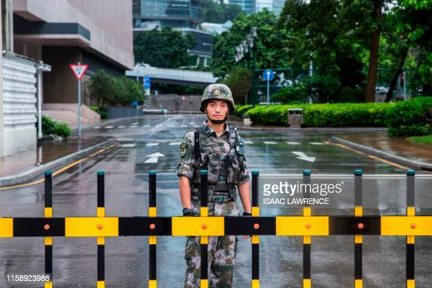 A Chinese People's Liberation Army soldier guards the entrance to the PLA Forces Hong Kong Building which is the headquarters for the PLA Hong Kong...