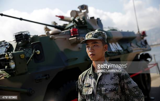 A Chinese Peoples' Liberation Army soldier stands to attention in front of a military vehicle at the Ngong Shuen Chau Barracks in Hong Kong on July 1...