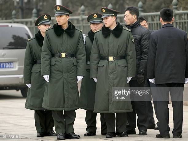 Chinese People's Liberation Army soldiers gather outside the Great Hall of the People in Beijing on March 4 2010 a day before the opening session of...