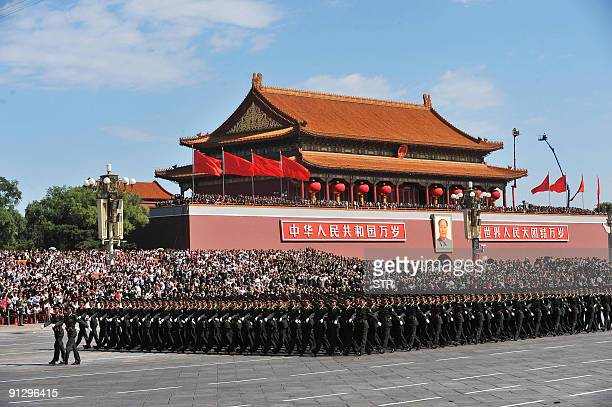 Chinese People's Liberation Army soldiers march past Tiananmen Square during the National Day parade in Beijing on October 1 2009 China formally...