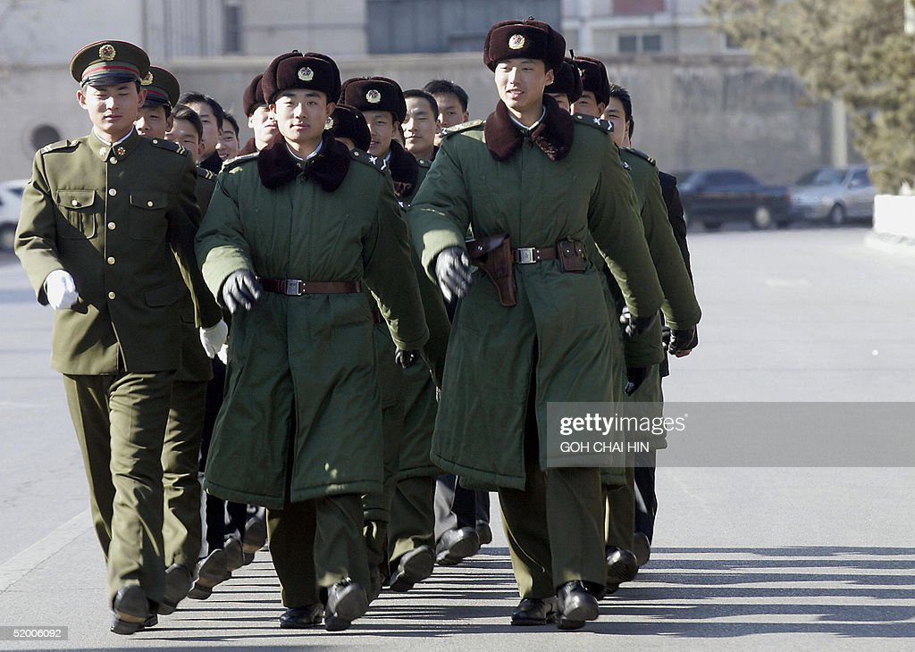Chinese People's Liberation Army soldiers march to their ...