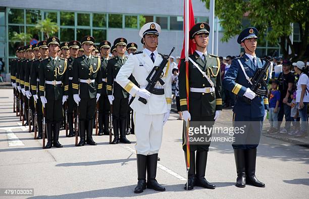 Chinese Peoples' Liberation Army soldiers stand in formation at the Ngong Shuen Chau Barracks in Hong Kong on July 1 to mark the 18th anniversary of...
