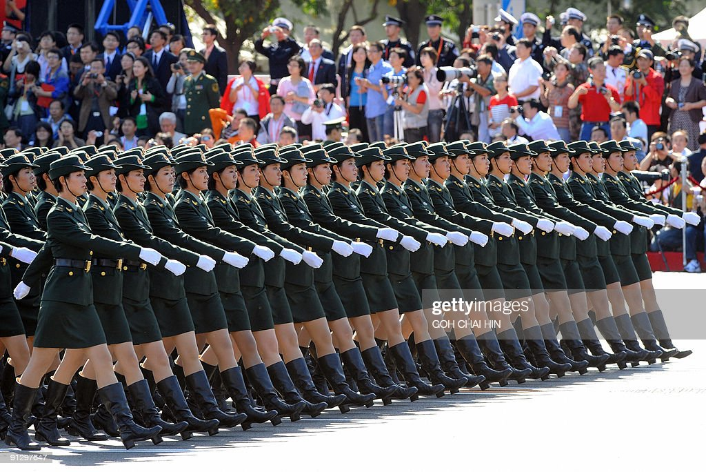 Chinese People's Liberation Army women soldiers march past ...