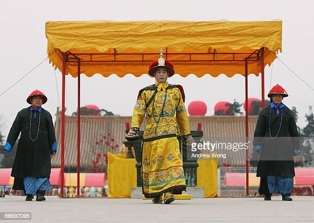 Chinese performer dressed as a Qing Dynasty emperor offers prayers during a reenactment of a sacrifice ceremony at the Temple of Earth on the eve of...