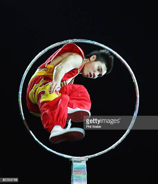 A chinese performer leaps through a ring during the New Zealand flagbearing ceremony ahead of the Beijing 2008 Olympics on August 7 2008 in Beijing...
