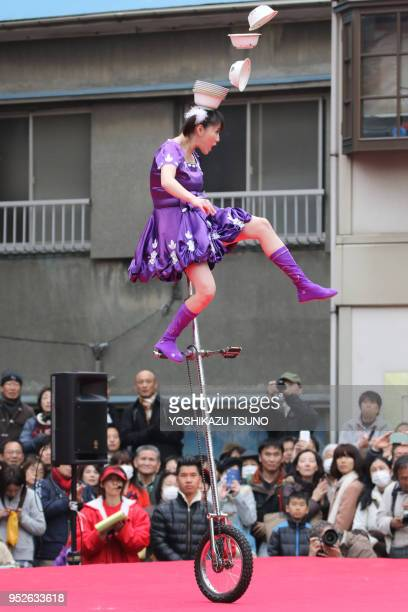 A Chinese performer on a unicycle performs to celebrate Chinese Lunar New Year at Yokohama Chinatown in Yokohama suburban Tokyo on January 29 2017...