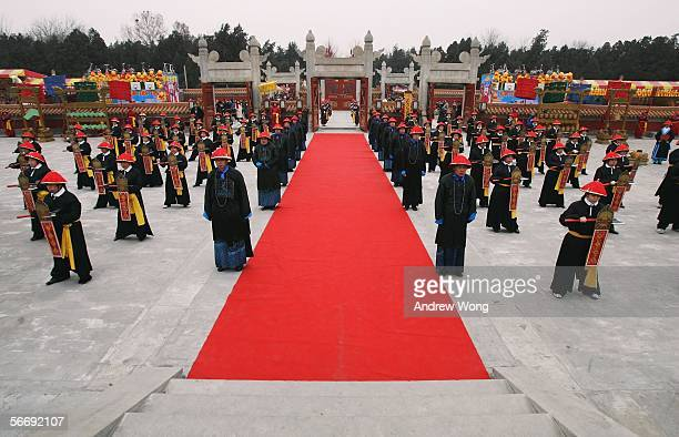 Chinese performers dressed as Qing Dynasty imperial guards take part in a reenactment of a sacrifice ceremony at the Temple of Earth on the eve of...