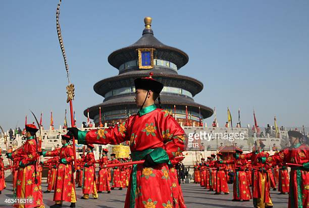 Chinese performers re-enact a traditional Qing Dynasty ceremony in which emperors prayed for good fortune at the Temple of Heaven in Beijing on...