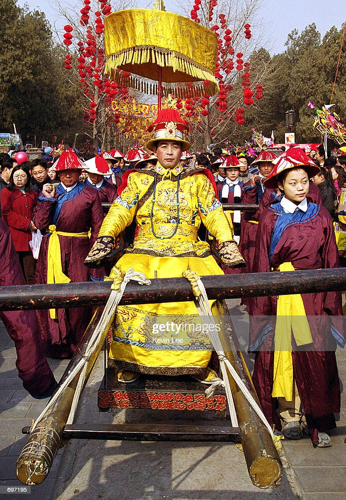 chinese performers reenact the ancient rite of the emperor during a temple fair february 13 - Chinese New Year 2002