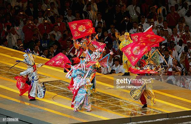 Chinese performers take part to mark the handing over of the Games to Beijing in 2008 during the closing ceremonies of the Athens 2004 Summer Olympic...