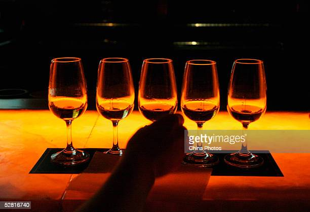 A Chinese person takes a glass of whisky at the Johnnie Walker Black Label Tasting Party on May 12 2005 in Chengdu of Sichuan Province China Johnnie...
