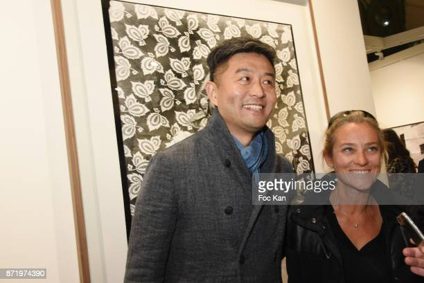Chinese photographer/artist Liu Bolin attends Paris Photo 2017 Preview at Grand Palais on November 8 2017 in Paris France