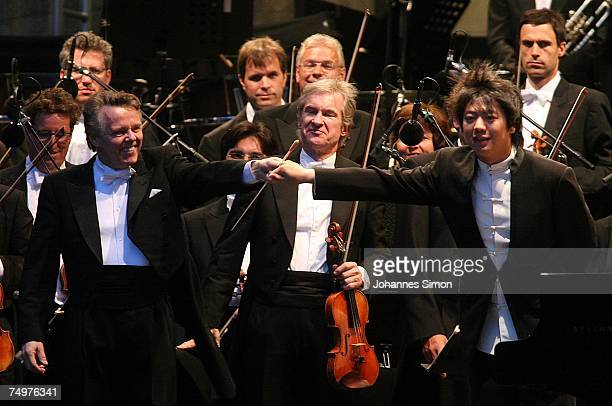 Chinese pianist Lang Lang and conductor Mariss Jansons gesture after giving an open air concert at Odeonsplatz square July 1 2007 in Munich Germany