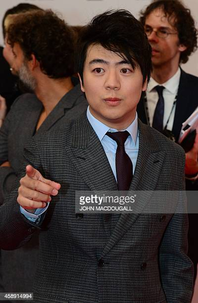 Chinese pianist Lang Lang poses as he arrives for the Bambi awards on November 13 2014 in Berlin The Bambis are the main German media awards AFP...