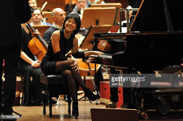 Chinese pianist Wang Yuja smiles during a rehearsal at the National Concert Hall in Taipei on March 6 2014 The London Symphony Orchestra will perform...