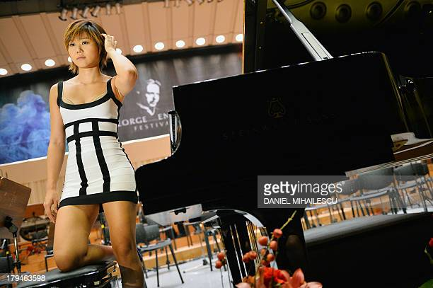 Chinese pianist Yuja Wang poses after the rehearsal of Tchaikovsky's First Concerto No 1 on the stage of the classical music Festival George Enescu...