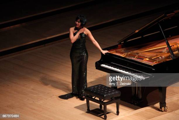 Chinese pianist Yuja Wang receives the applauds from the audience during a solo piano recital performing works by composers Chopin and Brahms as part...