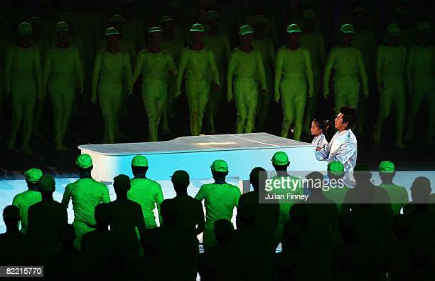 Chinese piano player performs during the Opening Ceremony for the 2008 Beijing Summer Olympics at the National Stadium on August 8 2008 in Beijing...