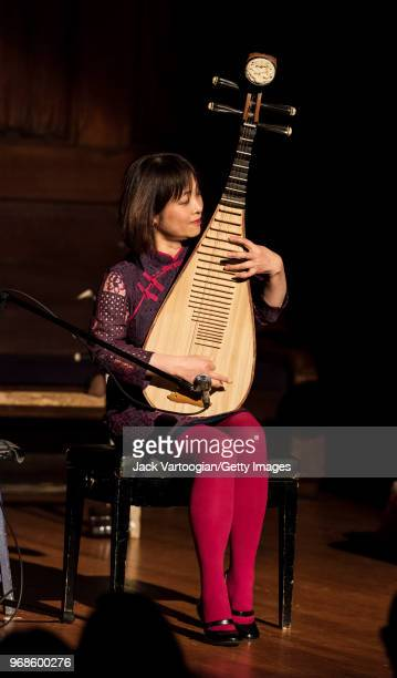 Chinese pipa player and cultural ambassador Wu Man performs at a World Music Institute and Asia Society concert at the New York Society for Ethical...
