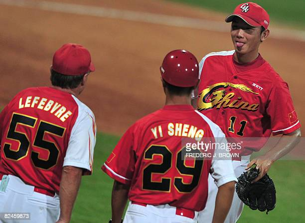 Chinese pitcher Liu Kai reacts as manager Jim Lefebvre and coach Yi Sheng head to the mound to pull him from the game in the bottom of the sixth...