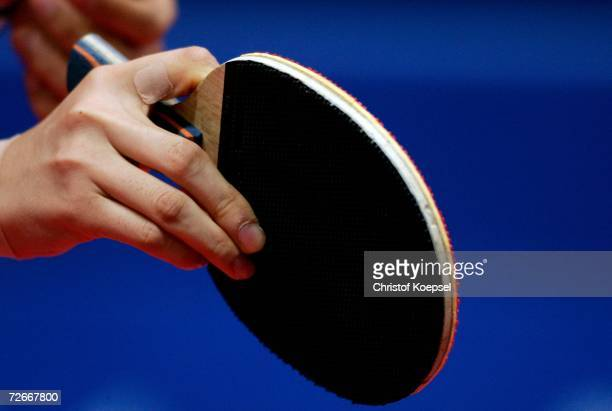 Chinese player grips the racquet during the Women's Team round one at 15th Asian Games Doha 2006 at AlArabi Indoor Hall November 29 2006 in Doha Qatar