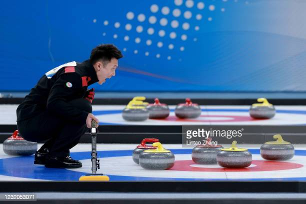 """Chinese player reacts after takes part in Gurling group A at Water Cube on April 1, 2021 in Beijing, China. A """"Meet in Beijing"""" ice test event for..."""