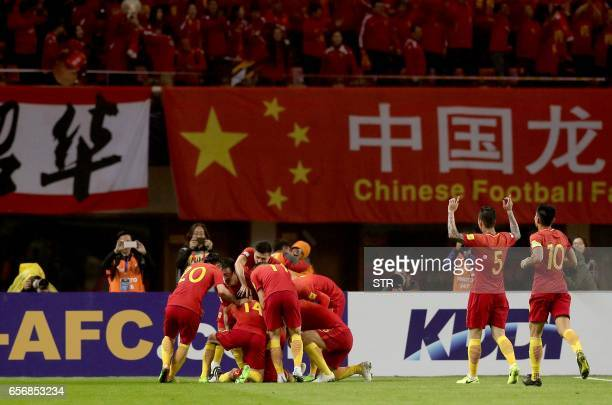 Chinese players celebrate after Yu Dabao scored during the World Cup football qualifying match against South Korea in Changsha China's central Hunan...