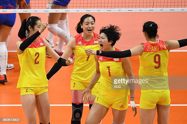 Chinese players celebrate during the Volleyball Women's Gold Medal Match between Serbia and China on Day 15 of the Rio 2016 Olympic Games at the...