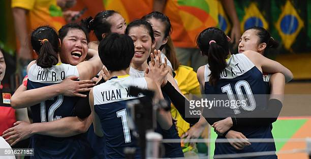 Chinese players celebrate during the Women's Quarterfinal match between China and Brazil on day 11 of the Rio 2106 Olympic Games at the Maracanazinho...