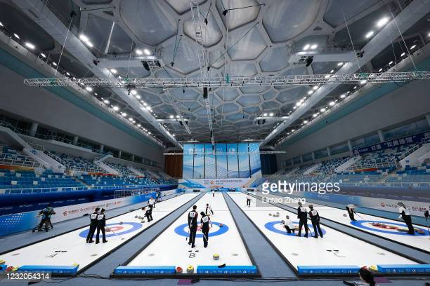 """Chinese players compete in the Curling mixed group A at Water Cube on April 1, 2021 in Beijing, China. A """"Meet in Beijing"""" ice test event for the..."""