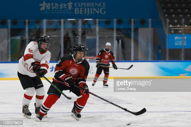 Chinese players from Beijing University and the Renmin University of China during a game at the ice hockey test event for the Beijing 2022 Winter...