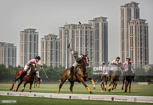 Chinese players from the Metropolitan Polo Club team in white and players from the United States and Great Britain play an exhibiton match at the...