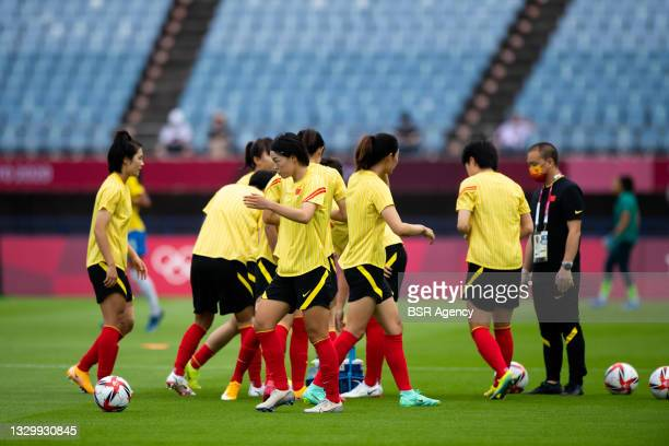 Chinese players warming up during the Tokyo 2020 Olympic Football Tournament match between China and Brazil at Miyagi Stadium on July 21, 2021 in...