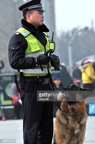 Chinese police and his dog
