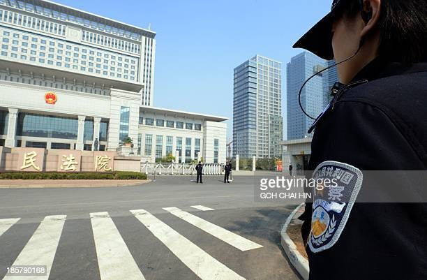 Chinese police guard the Shandong high court building in Jinan east China Shandong province on October 25 2013 A Chinese court rejected fallen...